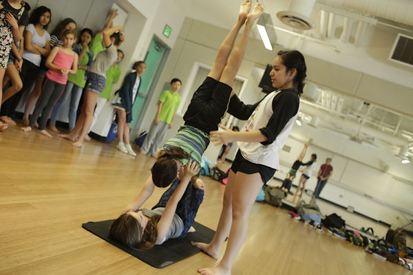 2 campers practice a biomechanic balance