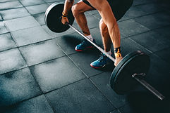 person-holding-barbell-841128.jpg