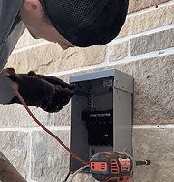 Electrician installing 220v Hot tub outlet Alaska