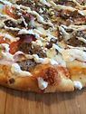 seasoned lamb, pizza fairbanks, flatbread, college town pizzeria, italian food, greek flatbread, fresh pizza, brick oven