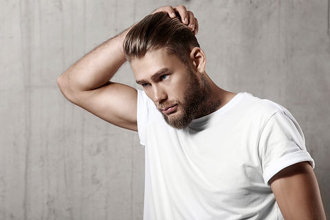 Handsome bearded man in a blank white t-