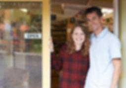 Portrait Of Couple Running Delicatessen