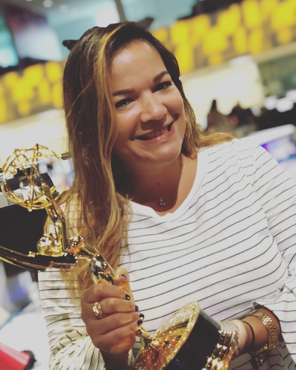 Sely Colón with the Emmy