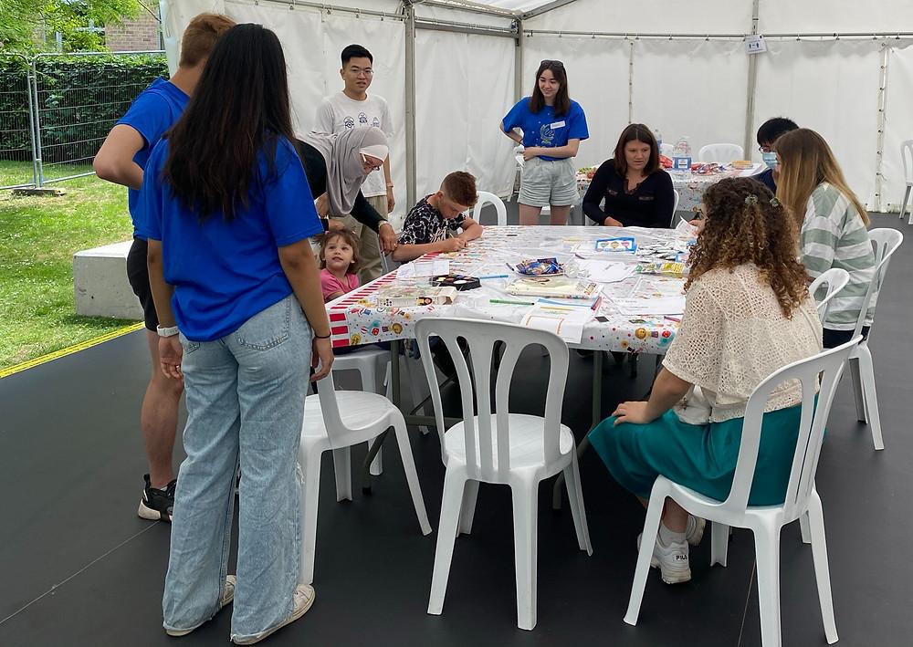 Jacari volunteers and pupils doing activities in a marquee