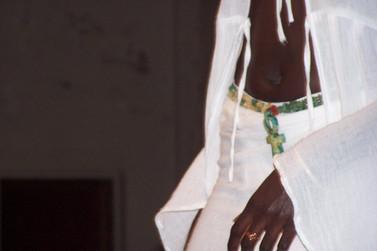 Ankh necklace worn as belt