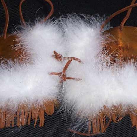 Copper, feather, leather bra detail