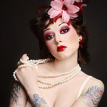 Portrait of a vintage woman with tattoos and a flower