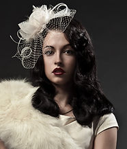 Portrait of a vintage woman with dark hair and a lace hat