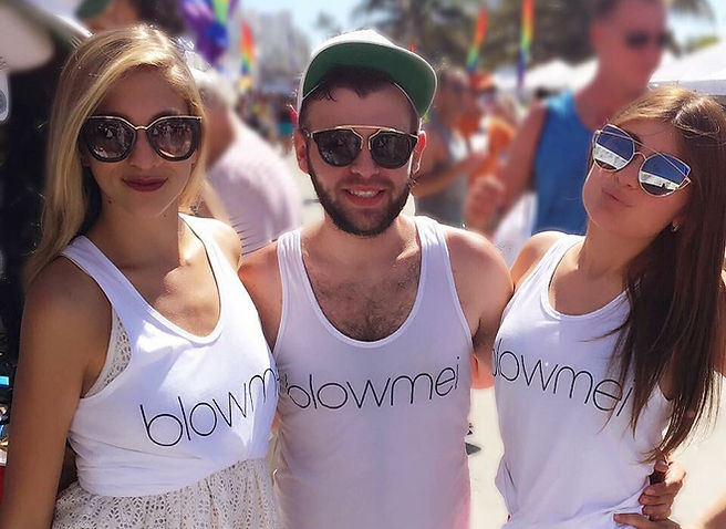 happy young people wearing blowmei t-shirts