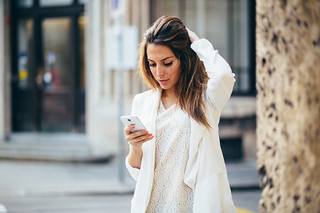 Woman with neck pain while texting