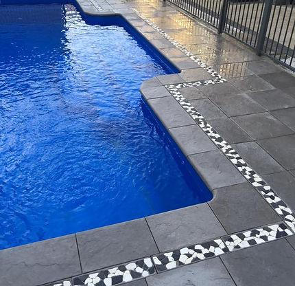 Swimming pool, poolside bullnose, pebble border