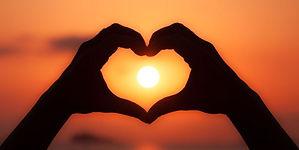 f22-160214-heart-hands-sunset.jpg