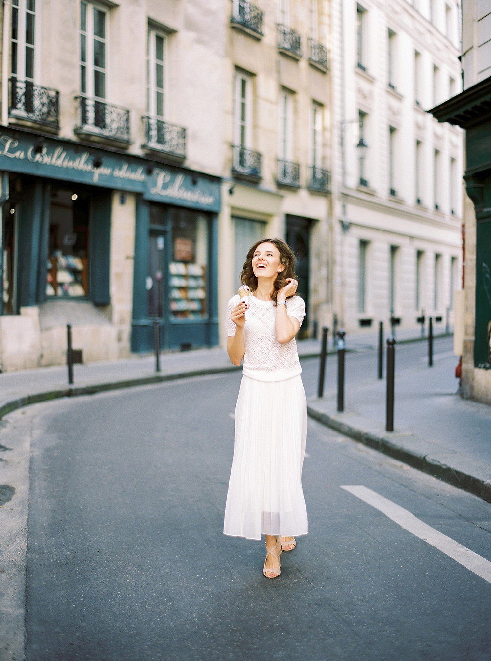 Parisian streets and girl with ice-cream in wight dress