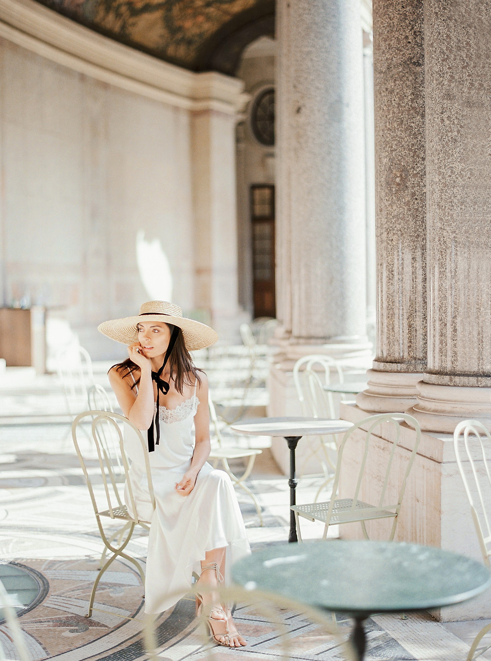 Girl with Mango hat  in Petit Palais cafe and total white outfit idea