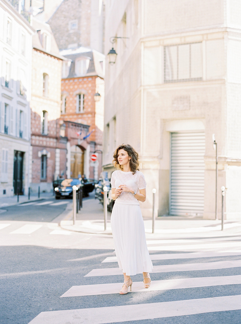 Parisian streets and girl in total wight outfit and Jimmy Choo sandals
