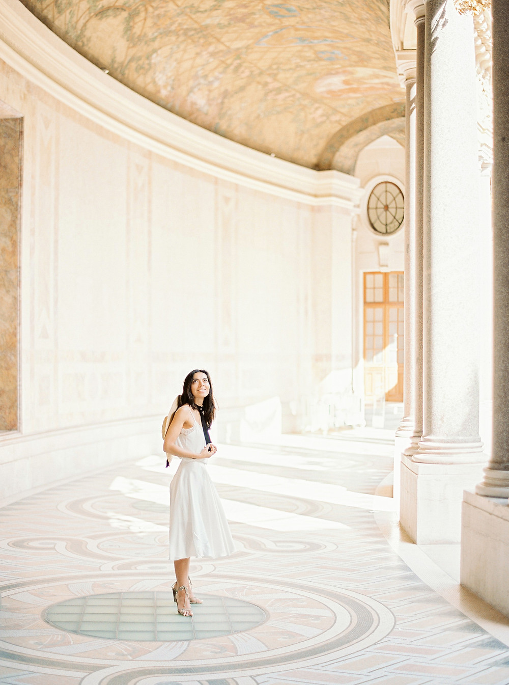 girl in white dress and hat at the Petit Palais  in Paris