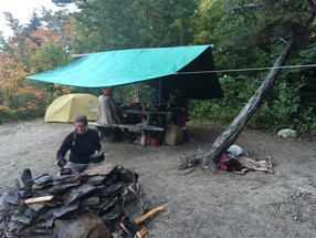 Fire cooking, crafts at the picnic table.