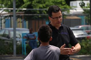 David Beidel talking to a kid.png
