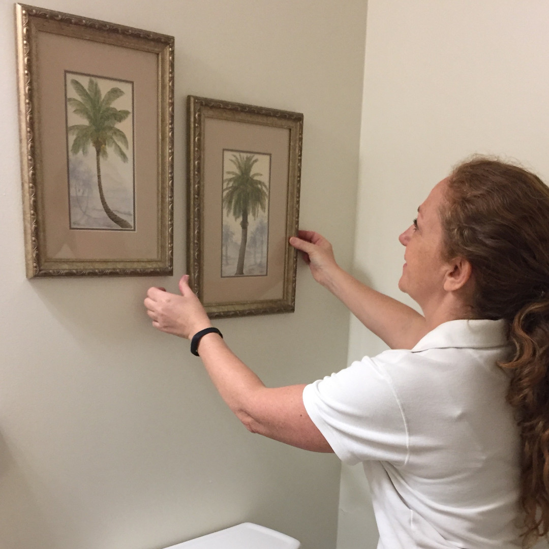 Jill hanging pictures.jpg