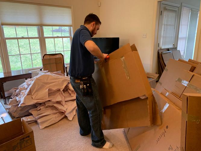 Nate breaking down boxes.jpg