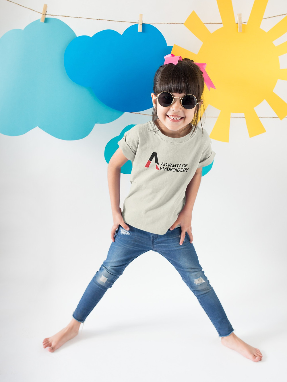 A young girl plays in sunglasses