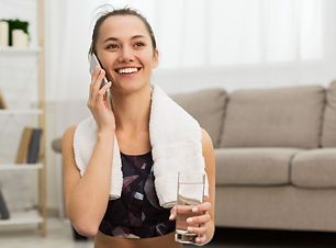 fit-girl-talking-on-phone-after-exercisi