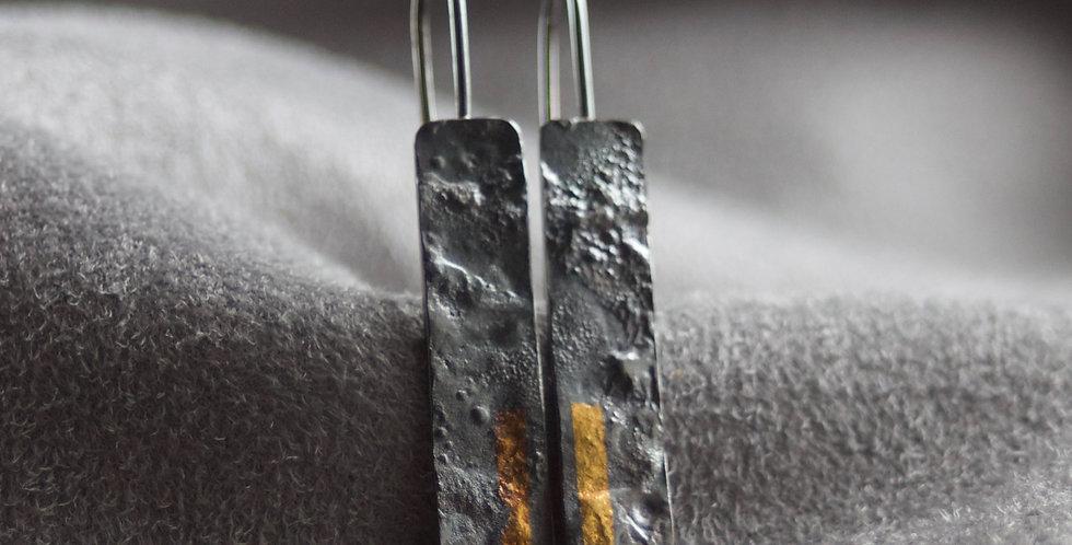 LINEAR Oxidised Long Drop Earrings on fabric