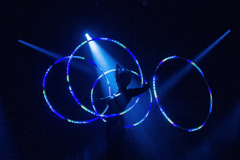Hire Hula Hoops Dancer - Ofelia LED Hula Hoop act - London - UK | Red Panda Agency Entertainment