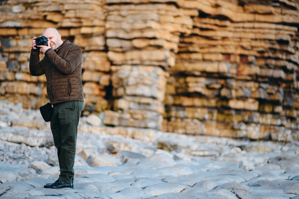 Photographer on the sea side Wales