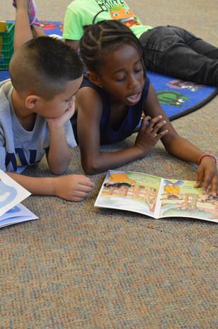 2 kids reading afri.jpg