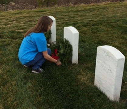 One of our members lays a wreath at a veteran's grave