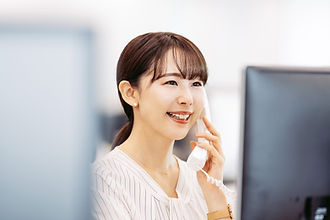 Young asian businesswoman using a teleph