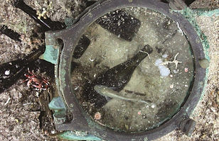 A porthole and artifacts from the SS Republic shipwreck.