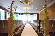 Ceremony Set up with Chair Covers and Sashes, Aisle Carpet/Runner, Aisle Lanterns, Rose Petals, Aisle Podiums, Manzanita Trees, Led Backdrop Curtain, Light up Love Letters and Table Swagging.
