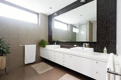 bigstock-Black-Mosaic-Tiled-Splashback--115844603
