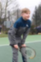 Deaf boy enjoying tennis