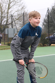 Deaf boy enjoying tennis