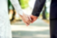 Closeup view of married couple holding h