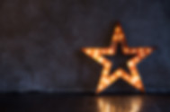 Decorative star with lamps on a backgrou
