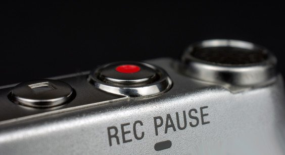dictaphone closeup of a red record butto