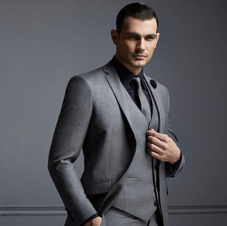 Three-piece grey suit with a black shirt