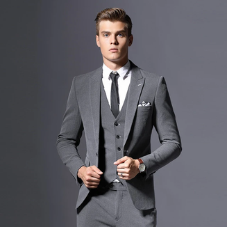Classic grey three-piece suit with peaked lapel