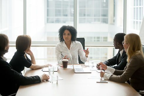 Black-female-boss-leading-corporate-meet