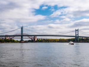 Robert F Kennedy Bridge with rail bridge behind, September 2019