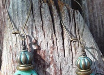 Aqua bird Czech bead earrings with bronze findings and kidney shaped ear wires.
