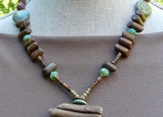 Agate and wood beaded necklace with a driftwood and ceramic bead pendant.
