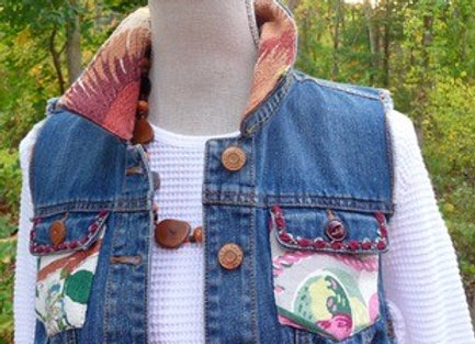 Upcycled cotton denim vest embellished with Vintage Bark Cloth and Vintage Butto