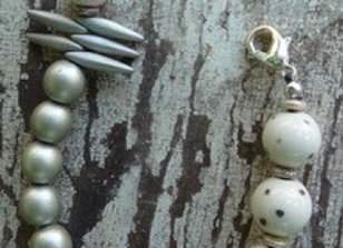 Grey and white ceramic beaded bracelet with Czech grey daggers.