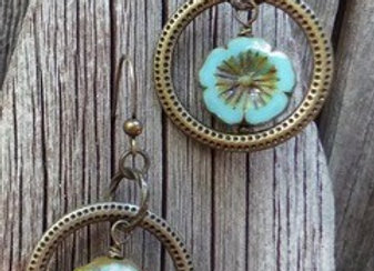 Aqua floral Czech bead earrings with bronze rings.