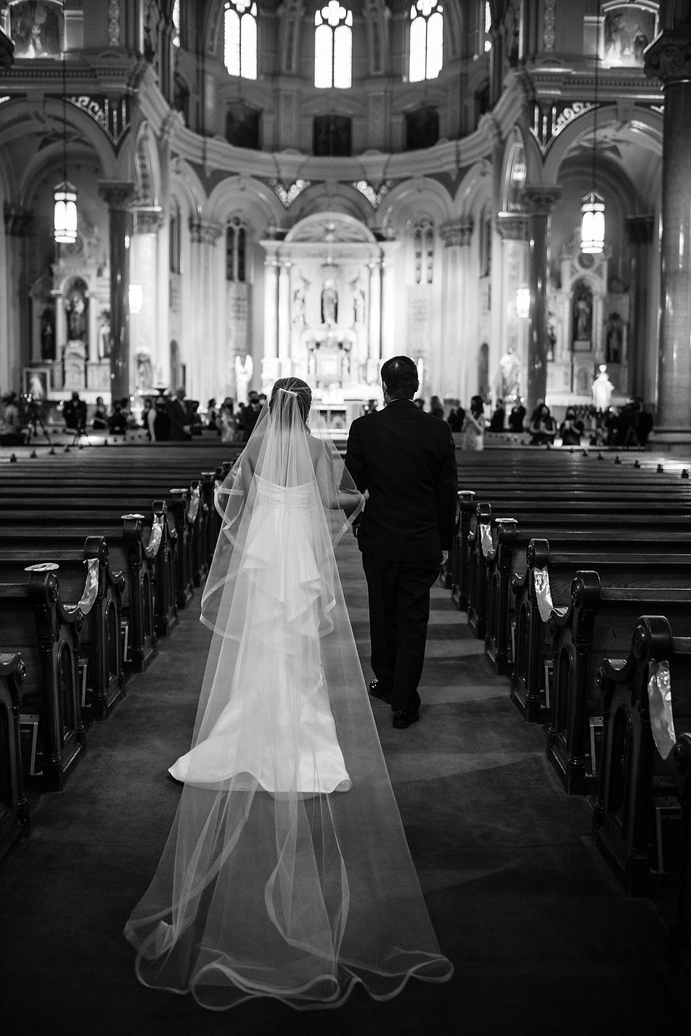 Niki Marie Photography bride walking down the aisle at Old St Mary's Church.